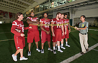 Hawgs Illustrated /BEN GOFF @NWABENGOFF<br /> Austin Allen (8), Arkansas senior quarterback, helps Andy Shupe, NWA Democrat-Gazette photojournalist, set up a photo with members of the Arkansas offensive line Saturday, Aug. 5, 2017, during Arkansas football media day at the Fred W. Smith Football Center in Fayetteville.