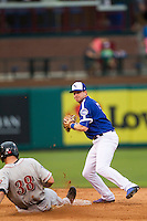 Oklahoma City Dodgers shortstop Elliot Johnson (5) turns a double play as Nashville Sounds baserunner Nate Freiman (38) slides into the bag during the Pacific Coast League baseball game on June 12, 2015 at Chickasaw Bricktown Ballpark in Oklahoma City, Oklahoma. The Dodgers defeated the Sounds 11-7. (Andrew Woolley/Four Seam Images)