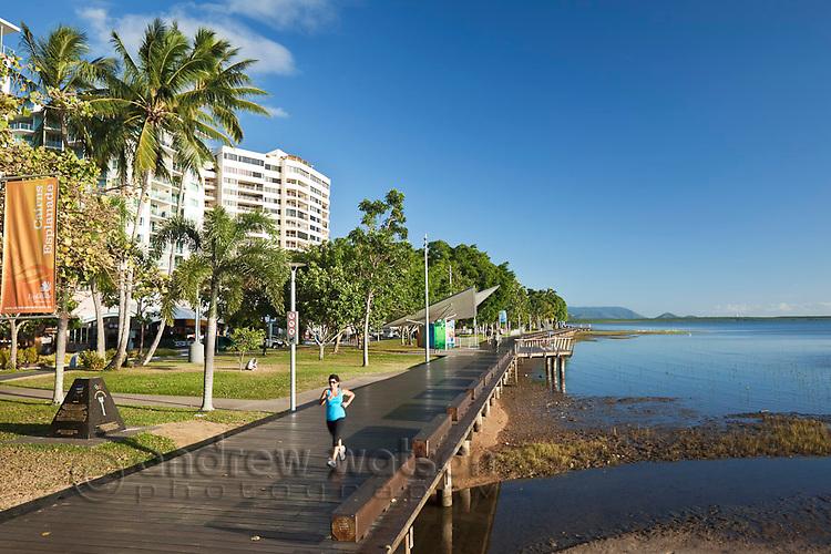 Jogger on the Esplanade boardwalk.  Cairns, Queensland, Australia