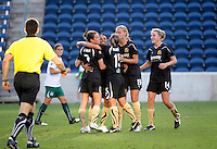 FC Gold Pride forward Marta (10) gets a hug from her teammates after scoring the game winning goal on a penalty kick.  The FC Gold Pride defeated the Chicago Red Stars 3-2 at Toyota Park in Bridgeview, IL on August 22, 2010