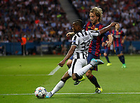 Calcio, finale di Champions League Juventus vs Barcellona all'Olympiastadion di Berlino, 6 giugno 2015.<br /> Juventus' Patrice Evra, left, is challenged by FC Barcelona's Ivan Rakitic during the Champions League football final between Juventus Turin and FC Barcelona, at Berlin's Olympiastadion, 6 June 2015. Barcelona won 3-1.<br /> UPDATE IMAGES PRESS/Isabella Bonotto