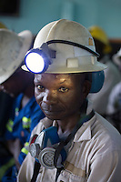 MUFULIRA, ZAMBIA- JULY 6: A mine worker waits to descend underground for an 8-hour shift mining copper in one of the shafts at Mopani on July 6, 2016. Glencore, an Anglo-Swiss multinational commodity trading and mining company, owns about 73 % of the mine, which produces copper and some cobalt. The mine employs about 15,000 people. (Photo by Per-Anders Pettersson)
