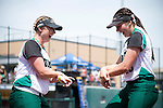 21 MAY 2016:  Rachel Barker (16) and Illa Haley (13) of Humboldt State University have some fun prior to taking on the University of North Alabama during the Division II Women's Softball Championship held at the Regency Athletic Complex on the Metro State University campus in Denver, CO.  North Alabama defeated Humboldt State 10-1 to force a game three.  Jamie Schwaberow/NCAA Photos