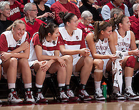STANFORD, CA - January 8, 2011: The Stanford Cardinal women's basketball team laughs while watching teammate Toni Kokenis play with only one shoe during Stanford's game against Arizona State at Maples Pavilion. Stanford won 82-35.