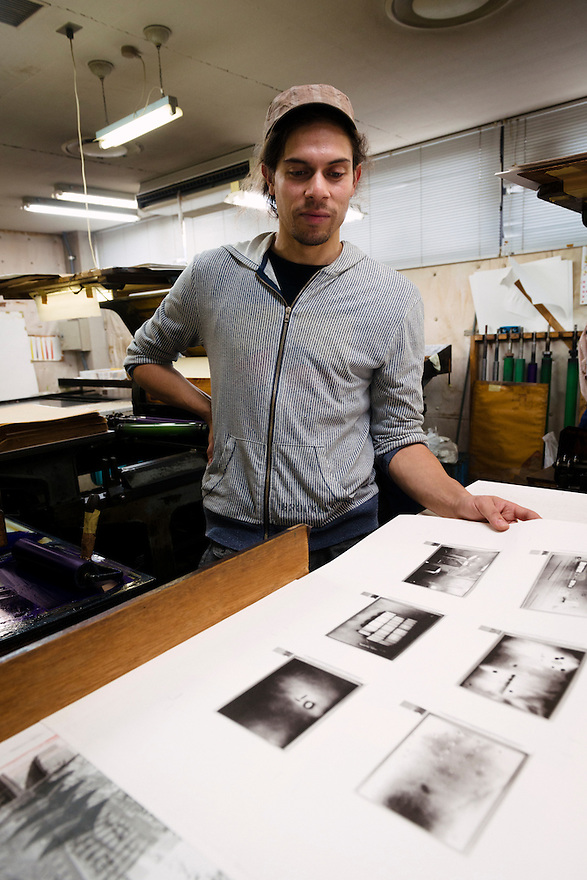 Photographer Antony Cairns with one of his collotype prints. Benrido collotype atelier, Kyoto, Japan, October 9, 2015. The Benrido collotype atelier in Kyoto was founded in 1887 and is the only full-scale commercial collotype atelier in the world. Collotype is a historic photographic printing process that makes use of plates coated in gelatine. It produces prints of unrivalled quality.