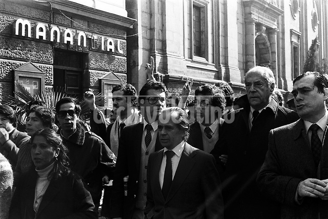 En Santiago Chile distintas organizaciones sociales, politicas, sindicales y estudiantiles realizaron manifestaciones en distintos puntos de la ciudad para celebrar el Dia Por La Vida y llamar al gobierno a terminar con la cultura de muerte.<br /> Santiago 9 Agosto 1985<br /> Forty years ago, on September 11, 1973, a military coup led by General Augusto Pinochet toppled the democratic socialist government of Chile. President Salvador Allende was killed during the  attack to seize  La Moneda presidential palace.  In the aftermath of the coup, a quarter of a million people were detained for their political beliefs, 3000 were killed or disappeared and many thousands were tortured.<br /> Some years later in 1981, while Pinochet ruled Chile with iron fist, a young photographer called Juan Carlos Caceres started to freelance in the streets of Santiago and the poblaciones or poor outskirts, showing the growing resistance against the dictatorship. For the next 10 years Caceres photographed every single protest and social movement fighting for the restoration of democracy. He knew that his camera was his only weapon, he knew that his fate was to register the daily violence and leave his images for the History.<br /> In this days Caceres is working to rescue and organize his collection of images in the project Imagenes de la Resistencia   . With support of some Chilean official institutions, thousands of negatives are digitalized and organized to set up the more complete visual heritage of this  violent period of Chile´s history.<br /> In a time when technology was not very friendly and communications were kind of basic, Juan Carlos Caceres and other photojournalist were always at the right place in the right moment defying the threats of the police. Their work is now  a visual heritage that documents and remind us the fight of Chilean people for democracy.