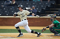 Chris Lanzilli (24) of the Wake Forest Demon Deacons follows through on his swing against the Notre Dame Fighting Irish at David F. Couch Ballpark on March 10, 2019 in  Winston-Salem, North Carolina. The Demon Deacons defeated the Fighting Irish 7-4 in game one of a double-header.  (Brian Westerholt/Four Seam Images)