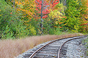 Autumn foliage along the old Maine Central Railroad in Carroll, New Hampshire USA.