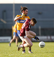 26th January 2020; TEG Cusack Park, Mullingar, Westmeath, Ireland; Allianz Football Division 2 Gaelic Football, Westmeath versus Clare; Anthony McGiveny (Westmeath) tries to control the ball under pressure from Cian O'Dea (Clare)