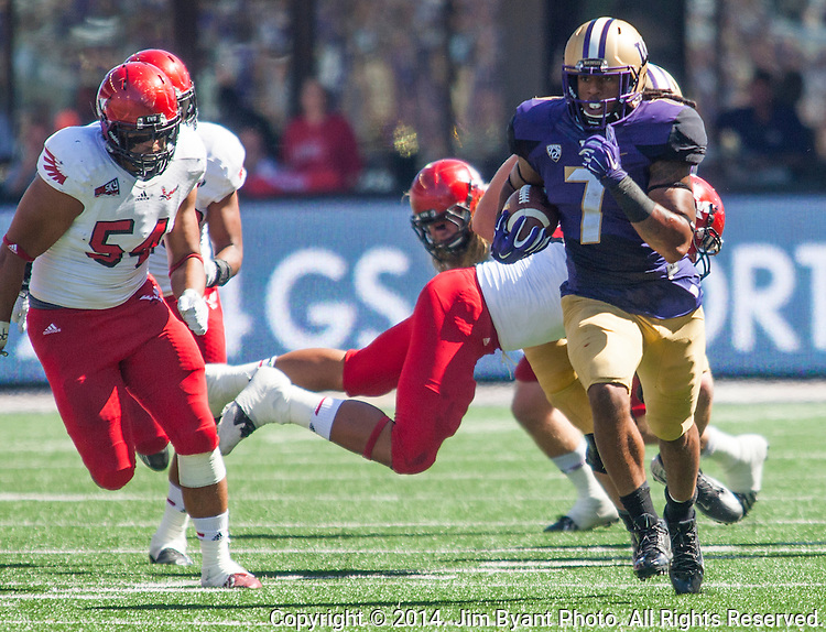 Washington Huskies'  running back Shaq Thompson (7) runs for a 57-yard touchdown against the Eastern Washington Eagles' at Husky Stadium September 6, 2014 in Seattle. Huskies out lasted the Eagles in a high powered shootout 59-52 in the third highest scoring game in Husky history. ©2014. Jim Bryant  Photo. All Rights Reserved