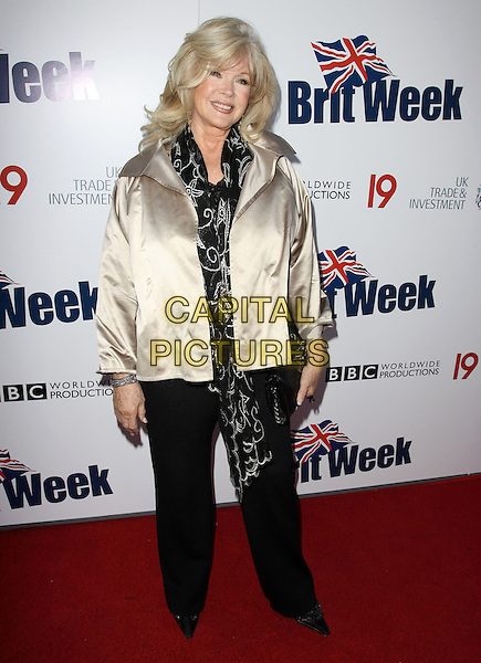 CONNIE STEVENS.The BritWeek 2010 Champagne Launch held At The British General Consul Residence, Los Angeles, California, USA..April 20th, 2010.full length black jacket trousers gold scarf silk satin.CAP/ADM/KB.©Kevan Brooks/AdMedia/Capital Pictures.