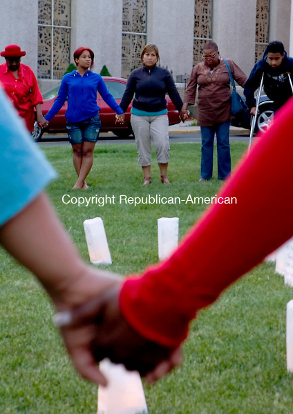 WATERBURY, CT- MAY 16 2010-051610JS05-Supporters gathered outside First Congregational Church in Waterbury on Sunday for a candlelight vigil to remember and give hope to victims of AIDS during the 27th International AIDS candlelight memorial. The event was organized by area faith community and AIDS Ministries. Also on hand were the City of Waterbury Health Department which provided testing and information, New Opportunities and the AIDS/HIV Assistance Program and a dance number by members of the Waterbury Baptist Ministries dance team. <br /> Jim Shannon Republican-American