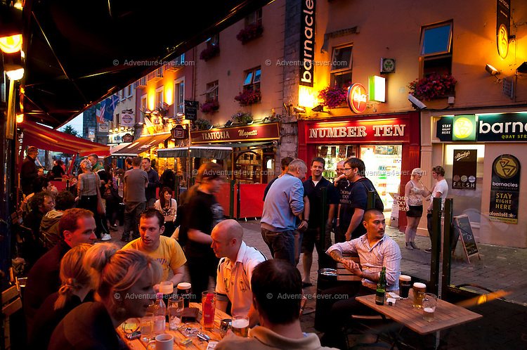 Galway city, Ireland, June 2010. Our fishing trip starts with a musical pub crawl through Quai Street in the center of town.  For centuries, Ireland has offered the greatest sport fishing to anglers. Several traditional houses offer accomodation and fishing in style, under the name 'The Great Fishing Houses of Ireland'.  Each of the houses has access to superb fishing. Some offer private, exclusive waters, while others are located on the great free lakes of Ireland. Photo by Frits Meyst/Adventure4ever.com