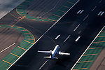 Aerial view of Continental Airline taking off or landing at San Diego International Airport.