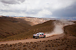 Car racer Cyril Depres from France driving his Peugeot -Total Red Bull car during the 5th stage of the Dakar Rally 2016 in the Bolivian Altiplano.