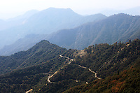 Stock photo: Hills of Sierra Nevada and roads from a distance view from above Moro Rock in the Sequoia national park California USA.