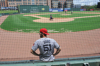 "Former Red Sox pitcher Daniel Bard contemplates his performance in a ""Sandlot""-style game concluding a series of workouts with local MLB and MiLB players from around the Upstate region on Thursday June 25, 2020, at Fluor Field at the West End in Greenville, South Carolina. Bard played for the Greenville Drive in 2007-2008, then Boston for five years and is now attempting a comeback with the Rockies. (Tom Priddy/Four Seam Images)"