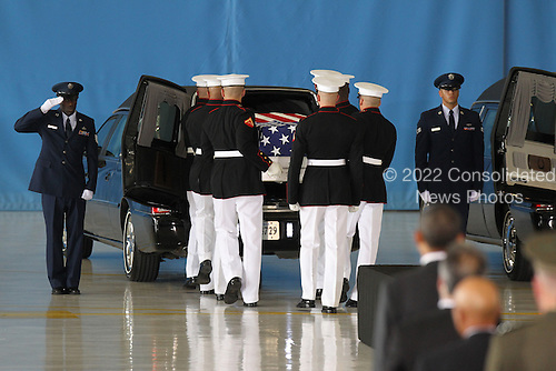 United States President Barack Obama watches while caskets are placed into vehicles during the Transfer of Remains Ceremony marking the return to the United States of the remains of the four Americans killed this week in Benghazi, Libya, at Joint Base Andrews on Friday, September 14, 2012..Credit: Molly Riley / Pool via CNP