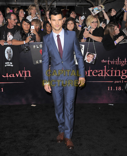 Taylor Lautner.The Los Angeles premiere of 'The Twilight Saga Breaking Dawn Part 1' at Nokia Theatre at L.A. Live in Los Angeles, California, USA..November 14th, 2011.full length suit blue purple tie .CAP/RKE/DVS.©DVS/RockinExposures/Capital Pictures.