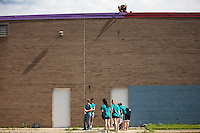 "Samantha Zent, top, paints on the roof during ""Circle the City with Service,"" the Kiwanis Circle K International's 2015 Large Scale Service Project, on Wednesday, June 24, 2015, at the Friendship Westside Center for Excellence in Indianapolis. (Photo by James Brosher)"