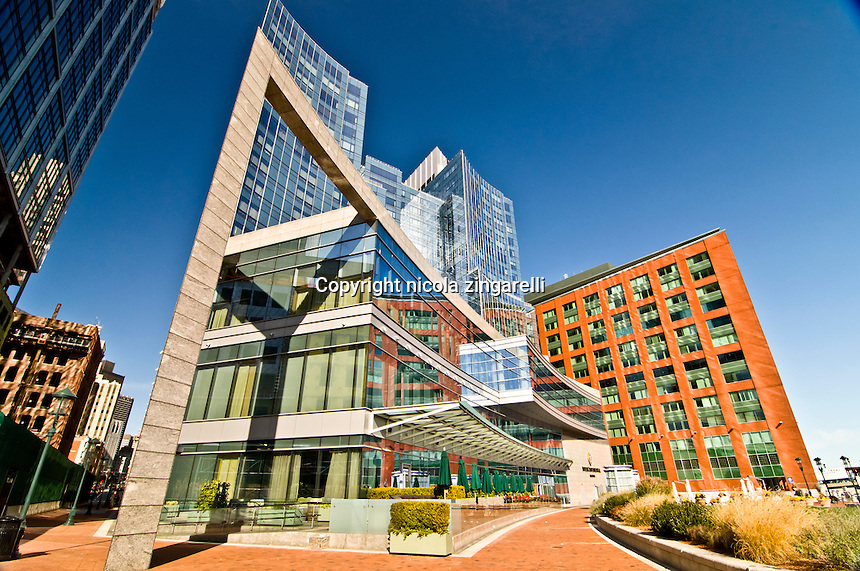 The intercontinental hotel in Boston sits by the river, is a very modern steel, concrete and glass building surrounded by more traditional bricks buildings