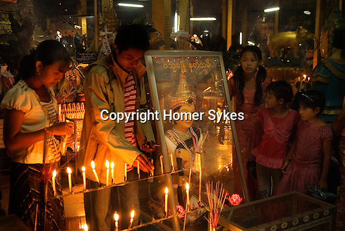 Full Moon festival, people in Buddhist temple. Sittwe Burma.
