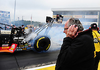 Oct. 2, 2011; Mohnton, PA, USA: NHRA team owner Connie Kalitta holds ear muffs as top fuel dragster driver Doug Kalitta does his burnout during the Auto Plus Nationals at Maple Grove Raceway. Mandatory Credit: Mark J. Rebilas-