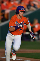 Center fielder Bryce Teodosio (31) of the Clemson Tigers runs out a batted ball in a game against the William and Mary Tribe on February 16, 2018, at Doug Kingsmore Stadium in Clemson, South Carolina. Clemson won, 5-4 in 10 innings. (Tom Priddy/Four Seam Images)