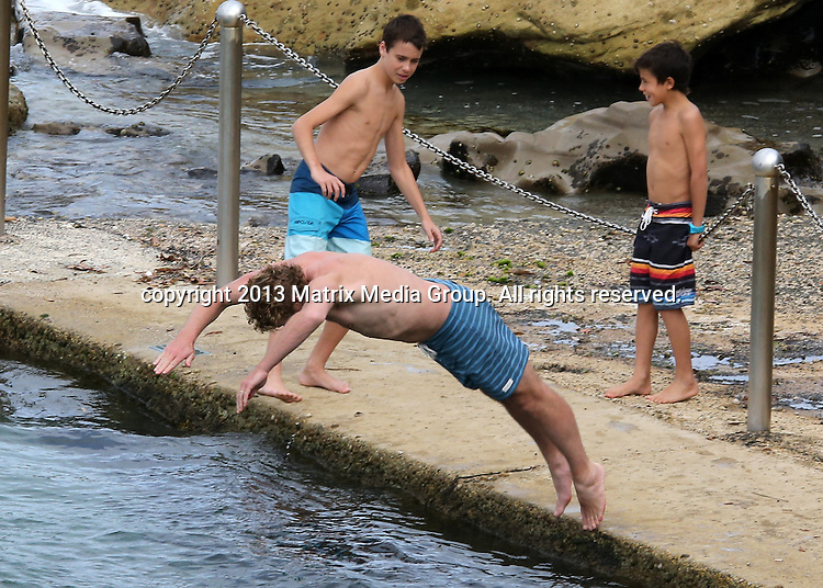 15 DECEMBER 2013 SYDNEY AUSTRALIA<br /> <br /> EXCLUSIVE <br /> <br /> Simon Baker pictured at Wylies Baths with his kids and friends including fellow actor Liev Schreiber.<br /> <br /> <br /> *No internet without clearance*<br /> MUST CALL PRIOR TO USE .<br /> +61 2 9211-1088<br /> Matrix Media Group<br /> Note: All editorial images subject to the following: For editorial use only. Additional clearance required for commercial, wireless, internet or promotional use.Images may not be altered or modified. Matrix Media Group makes no representations or warranties regarding names, trademarks or logos appearing in the images.