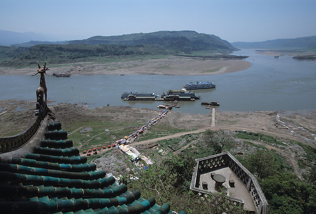Tourists crowd a muddy path after departing ships on the Yangtze River in China from The Shibao Pagoda at Shibaozhai, the Stone Treasure Village, China