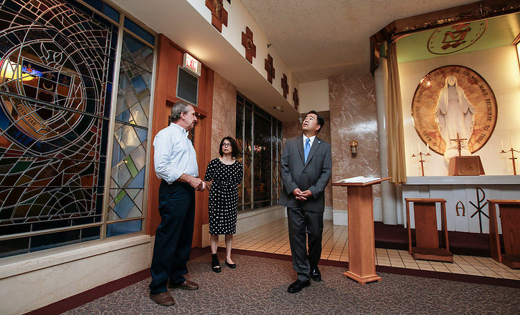 Bob Janis, left, vice president of facility operations, offers a tour of the Miraculous Medal Chapel to DePaul President A. Gabriel Esteban, Ph.D., and his wife Josephine Wednesday, July 5, 2017. The Estebans spent an hour getting acquainted with the Loop Campus during Dr. Esteban's first week. <br />