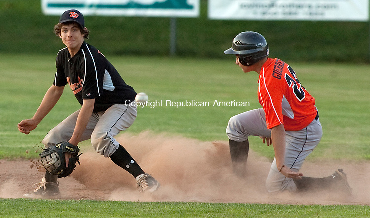 WATERTOWN, CT 29 JUNE, 2010-062910JS03--Water-Oak's team two's Rocco Guerrera, right, slides safely into second base bas Water-Oak's James Phillips awaits on the ball during their game Tuesday at Deland Field in Watertown.<br /> Jim Shannon Republican-American