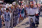 Bon Odori celebration and parade with dancers with fan celebrating Seattle Washington State USA