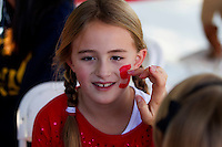 Abby Skov, has her face painted at Fan Fest before Saturday's, November 23, 2013, Big Game at Stanford University.