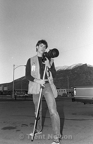 Trent Nelson posing with lens and gear.<br />