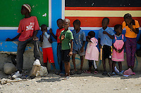 Haitian children wait in a line to enter Saint Claire, the education and feeding center run by a Christian organization in Port-au-Prince, Haiti, July 8, 2008.