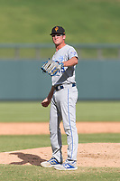 Surprise Saguaros relief pitcher Walker Sheller (49), of the Kansas City Royals organization, waits to receive the ball back from the catcher during an Arizona Fall League game against the Salt River Rafters at Salt River Fields at Talking Stick on October 23, 2018 in Scottsdale, Arizona. Salt River defeated Surprise 7-5 . (Zachary Lucy/Four Seam Images)