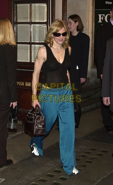 MADONNA RITCHIE.leaving Wyndams Theatre after her performance..jogging pants, puma trainers, sunglasses at night.www.capitalpictures.com.sales@capitalpictures.com.©Capital Pictures.