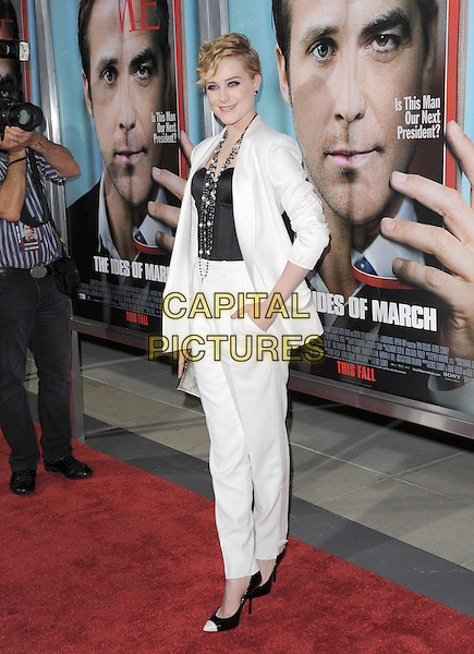 Evan Rachel Wood.The L.A. Premiere of 'The Ides of March' held at The Academy of Motion Picture Arts & Sciences  in Beverly Hills, California, USA..September 27th, 2011.full length suit blazer jacket clutch bag black white pearl corset necklace trousers two tone.CAP/RKE/DVS.©DVS/RockinExposures/Capital Pictures.