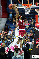 Washington, DC - MAR 7, 2018: La Salle Explorers center Tony Washington (5) has his shot blocked by Massachusetts Minutemen guard Carl Pierre (12) in game between La Salle and UMass during first round action of the Atlantic 10 Basketball Tournament at the Capital One Arena in Washington, DC. (Photo by Phil Peters/Media Images International)