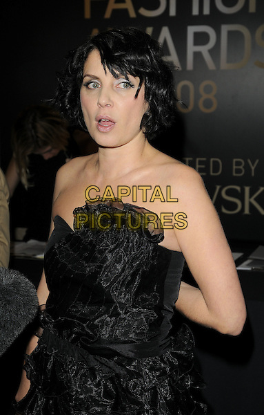 SADIE FROST.Inside arrivals at the British Fashion Awards 2008 held at The Lawrence Hall in London, England. UK, .November 25th 2008.half length strapless black dress ruffles ruffled mouth open.CAP/CAN.©Can Nguyen/Capital Pictures.