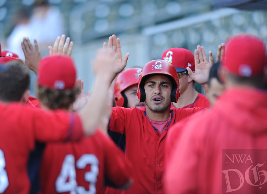 NWA Democrat-Gazette/ANDY SHUPE<br /> Springfield Cardinals shortstop Alex Mejia (center) is congratulated by teammates in the dugout Wednesday, June 7, 2017, after hitting a two-run home run during the Cardinals' four-run first inning at Arvest Ballpark in Springdale. Visit nwadg.com/photos to see more photographs from the game.