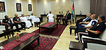 Palestinian Prime Minister Rami Hamdallah meets with head of the Omani Football union, Salem Al Wahaibi, in the West Bank city of Ramallah on June 14, 2017. Photo by Prime Minister Office