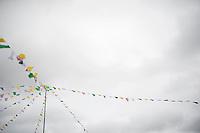 flags out for the Grand Départ - Official Teams Presentation in the historic village of Sainte-Mère-Eglise<br /> <br /> 103rd Tour de France 2016