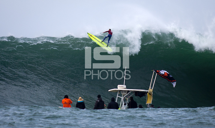 Half Moon Bay, California - January 24, 2014: 2014 Maverick's Invitational Anthony Tashnick attempts to pull out the back.