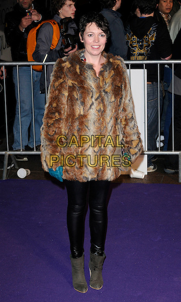 "OLIVIA COLMAN .The ""Paul"" UK Film Premiere, Empire Cinema, Leicester Square, London, England, UK, 7th February 2011..full length brown fur coat leather shiny pvc leggings ankle boots blue gloves grey gray clutch bag .CAP/CAN.©Can Nguyen/Capital Pictures."