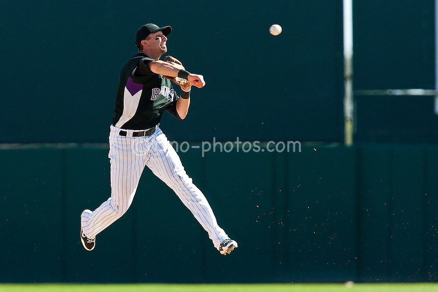 Mar 17, 2009; Tucson, AZ, USA; Colorado Rockies shortstop Troy Tulowitzki turns and throws to second to initiate a double play in the top of the 7th inning of a spring training game against the Kansas City Royals at Hi Corbett Field.  The Royals and the Rockies tied 9-9 after 10 innings.