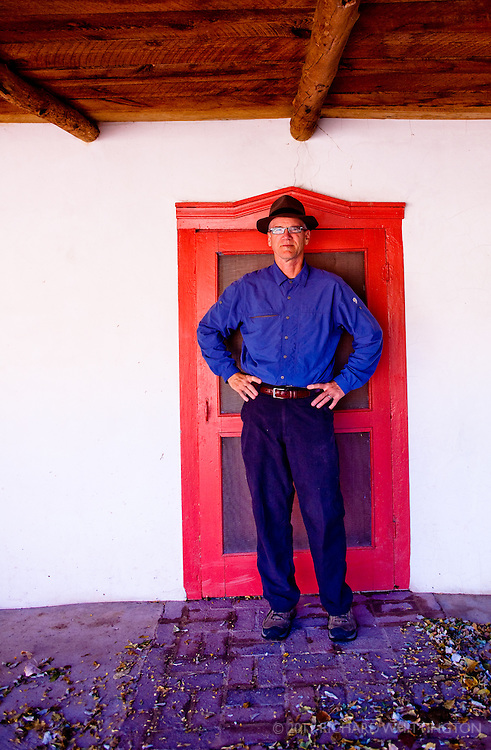 I am six feet tall in my socks so you can see how low these doorways were in the adobe structures in the 1700s. Rancho Jacon, New Mexico.