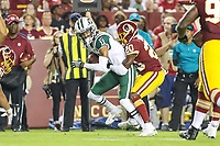 Landover, MD - August 16, 2018: New York Jets wide receiver Robby Anderson (11) is tackled by Washington Redskins defensive back Danny Johnson (20)during the preseason game between New York Jets and Washington Redskins at FedEx Field in Landover, MD.   (Photo by Elliott Brown/Media Images International)