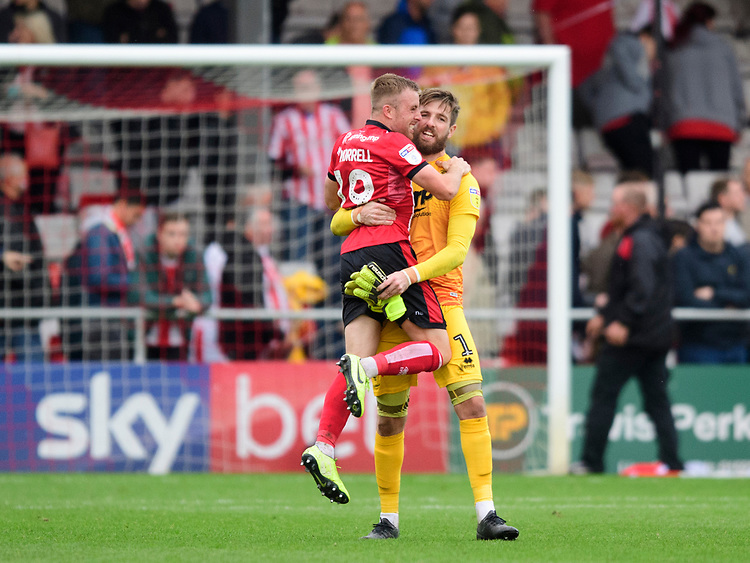 Lincoln City's Joe Morrell, left, and Lincoln City's Josh Vickers celebrate at the end of the game<br /> <br /> Photographer Chris Vaughan/CameraSport<br /> <br /> The EFL Sky Bet League One - Lincoln City v Sunderland - Saturday 5th October 2019 - Sincil Bank - Lincoln<br /> <br /> World Copyright © 2019 CameraSport. All rights reserved. 43 Linden Ave. Countesthorpe. Leicester. England. LE8 5PG - Tel: +44 (0) 116 277 4147 - admin@camerasport.com - www.camerasport.com